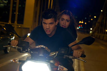 Taylor Lautner as Nathan and Lily Collins as Karen in &quot;Abduction.&quot;